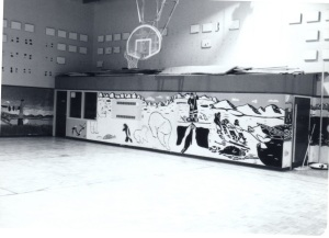 Photo of a high school gymnasium with a polar bear mural under the basketball hoop.