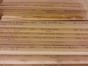 A close-up of an archival box filled with labeled folders.