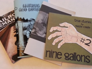Four zines fanned out with titles: Railroad Semantics, Learning Good Consent, untitled, and Nine Gallons #2.