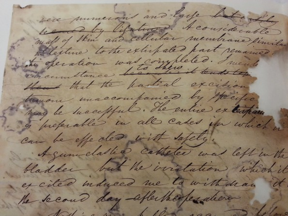A very old and damaged letter in cursive. Partial excerpt in caption.