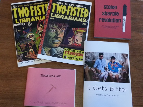 Four zines and a book, described below.