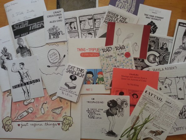 A jumble of zines on a table.