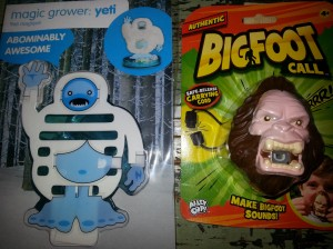 A close-up photo of two bigfoot toys, described below.