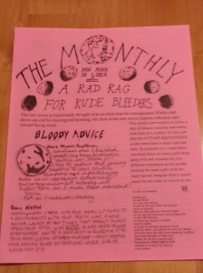 A full page zine on pink paper with moon imagery and text.