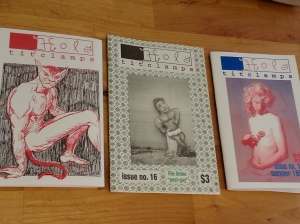 Three Holy Titclamps zines with homoerotic imagery.