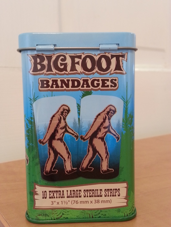 """This adorable bandaid tin contains extra large bandaids with an image of Bigfoot in classic """"Frame 352"""" pose. I found this item at a toy store in Portland, Oregon."""