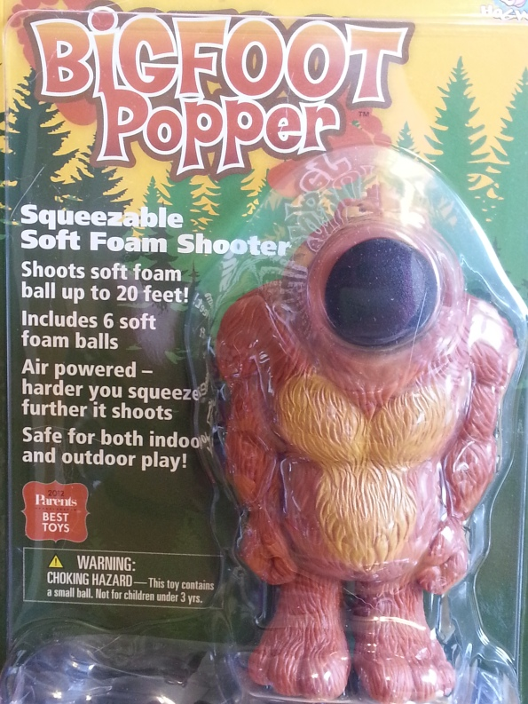 Plastic bigfoot toy with foam ball lodged in its mouth.