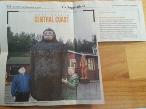 Newspaper clipping with photograph of large bigfoot statue dwarfing two people. Single paragraph blurb describes the Bigfoot Discovery Museum in Felton, CA.