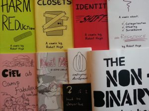 Nine zines grouped together on a table.