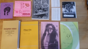 Several brightly-colored zines laying on a table.