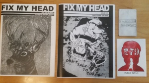 Several zines of different sizes laying on a table.