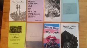 Several colorful zines laying on a table.